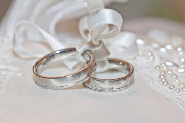 Wedding rings on silk sash