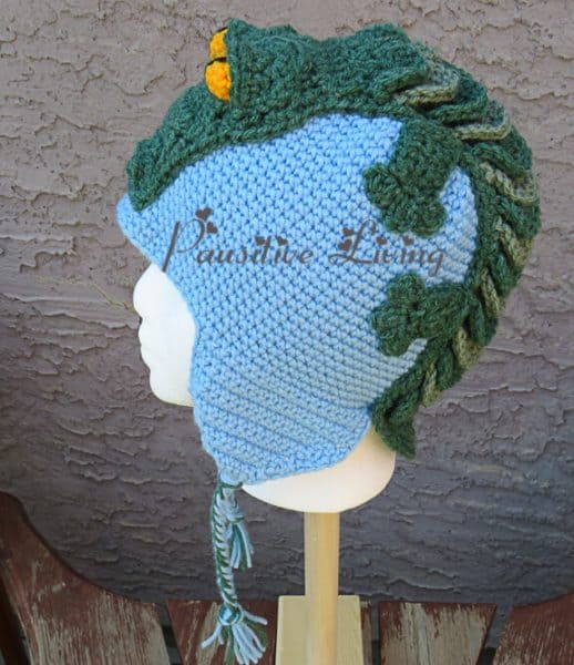 Crocheted crocodile hat, side view.  Christmas craft ideas.